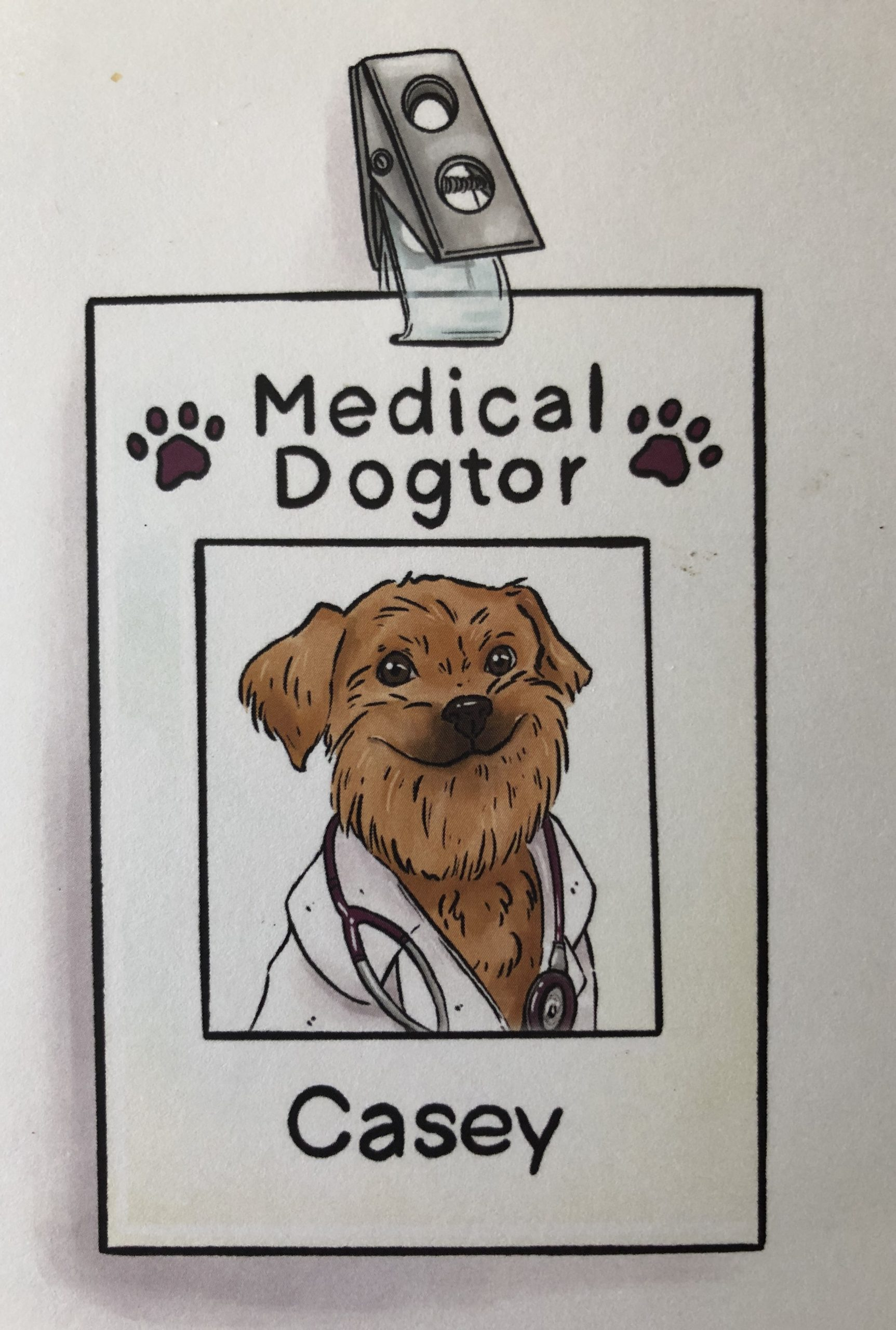 Drawing of name tag with smiling dog on it